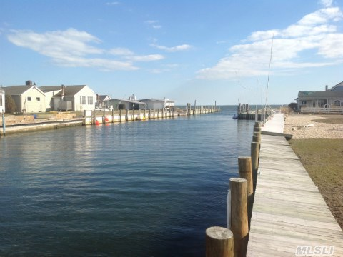 Calling All Investors.  Double Lot On Canal ~ Easy Access To Bay ~ Private Beach ~ 120 Ft. Of New Bulkhead.  Home Was Damaged From Sandy.  Amazing Potential To Expand Or Rebuild. Cash Deal Or 203K Loan