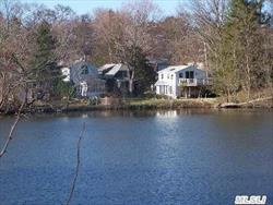 Legal Multi-Family:Main House Has 3Bd, 1.5Bths, Wood Flrs, Frplc & Bsmt.Small House Completely Renovated Has 2 Bd, 1Bth, Frlc, Wood Flrs, Elec.Heat And Bsmnt.Garage Has 1 Bd Appartment W/Deck And All Have Water Views.Owner Fins.Is Avail.Great Investment!!