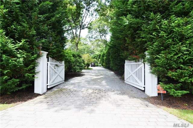 Sprawling Ranch Pristine & Totally Private, South Of Highway W/ Park Like Grounds. Huge Open Floor Plan W/ Large Living Rm. & Grand Fireplace, Chefs Kitchen, Dining Area & An Open Light Filled Family Room. Heated Gunite Pool Surrounded By Lush Landscaping & A Beautiful Pergola Terrace. Rm For A Tennis, Low Taxes & Quogue Beach Rights. Row To Stone Creek.