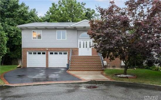 Perfect Opportunity To Add Your Finishing Touches To This Extra Lge Hi-Ranch W/ 5 Brs & 3 Full Ba. Upper Level: Bright & Airy Lr W/ Great Skylights, Flows To Fdr, Eik, Mbr W/ En Suite Ba & 2 Lge Closets,  2 Add'l Brs, Full Ba, Hw Floors. On Main Level 2 Brs And Fam Rm W/ Sliders Overlooking The Yard, Laundry Rm, 2 Car Garage. Desirable Merrick Schools. Hurry Won't Last!