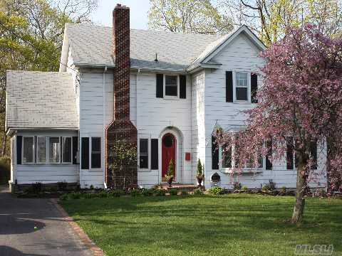 Colonial W/Old World Charm Close To Water In South Sayville. Features Lr W/Fplc, Heated Sunroom, Den, Large Eat-In-Kitchen, Hw Floors, Andersen Windows, Gas Heat, Sprinklers, Large Attic,Impresssive Brick Patio Overlooking Deep Fully Fenced Yard. Nothing To Do But Move Right In. A True Gem. Star Taxes $9535