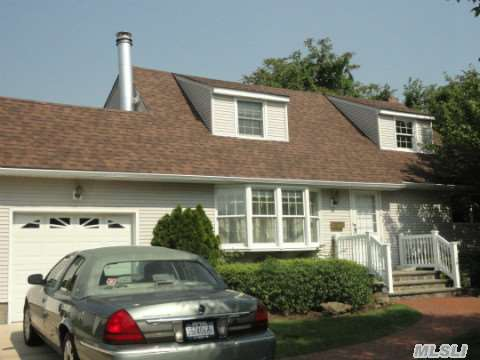 True Pride Of Ownership & Great Value In This Rear Dormered Westwood Cape In Sd 23. O'sized Property,  New Arch Roof,  Walkway,  Front Steps, Pvc Fence,  Kitchen Floor & Ss Appliances. Hardwood Floors Throughout, All Anderson Windows.House Has Natural Gas Line.Mid-Block Location.