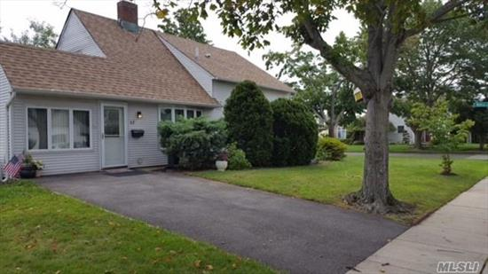 Don't Miss This 5 Bedroom, 2 Bath Expanded Ranch In Award Winning East Meadow School District.