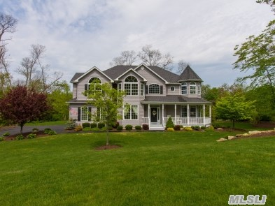 Beautiful Post Modern In Estate Section Of Roanoke Landing.  Located On A Cul-De-Sac With View Of L.I. Sound. 9' Ceilings,  Architectural Mouldings Throughout,  2 Ovens With Central Island Kitchen,  Automatic Natural Gas Generator,  And Much Much More.  Must Be Seen To Be Appreciated.