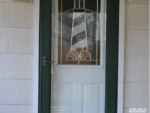 Stain glass light house on rear entrance