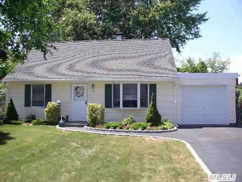 Good Starter Cape Or A Great Downsize Home Sits On Quiet Street In Award Winning Sd#23 Offers 4 Beedroom , Tiled Bath, Eat-In-Kitchen, Laundry Room, Garage, Patio And Walk To All, Stores, Parks, Schools, Lirr.