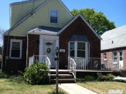 Lovely 4 Bedroom Cape With A Detached 2 Car Garage.  Full Partially Finished Basement With Dry Bar.  Original 1st Floor Hardwood Floors.  New Roof. No Neighbors Across The Street.  Convenient To All (Shopping,  Houses Of Worship,  City Buses,  Major Highways,  Etc.).