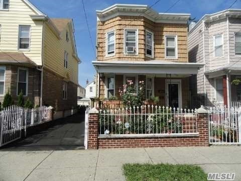 Excellent Condition Large 2 Family Income Producer. Outside Separate Entrance To Finished Basement. Large Private Driveway & 2 Car Garage. Big Backyard. Walk To Mta Train, Buses, Shopping And Restaurants On Atlantic Ave & Jamaica Ave. Short Drive To Jackie Robinson Parkway, Grand Central Pkwy, & Van Wyck Expwy.