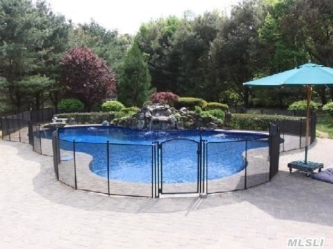Mountain Lake Pool with Safety Fence and Stone patios