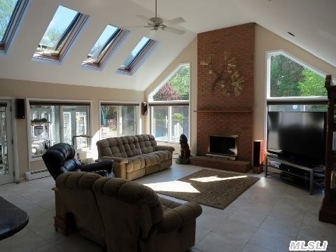 Light filled Great Room with Walls of Windows!