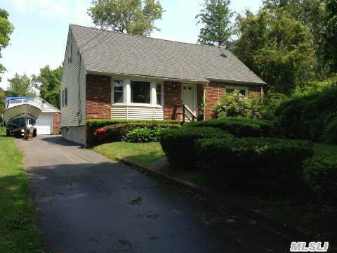 Beautifully Maintained Dormered Cape Cod Home,  Features All New Windows,  New Roof,  Brick& Vinyl Siding. Hardwood Flooring Under Carpet. Full Basement With Outside Entry. Nicely Set Back. Oversized Property. Inground Sprinklers.