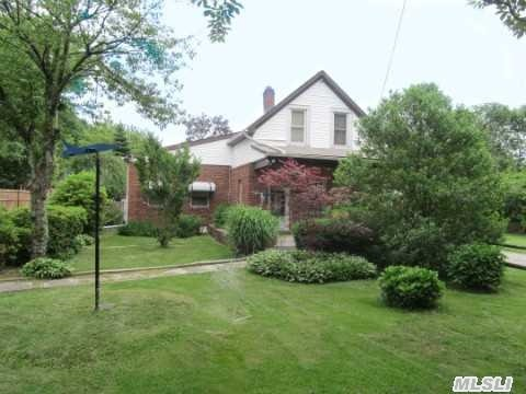 Very Low Taxes! Adorable 4 Bedroom,  2 (Updated) Bath Cape With Oversized 2 Car Garage,  Koi Pond....