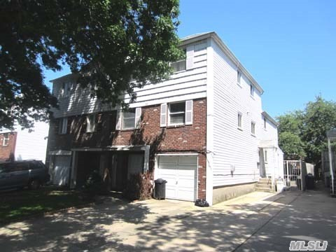 Semi-Detached Triplex/Duplex 2 Family In The Heart Of Bayside/Oakland Gardens Area.  Triplex Has 8 Foot Extension In Back Of House. Hardwood Floors Throughout.