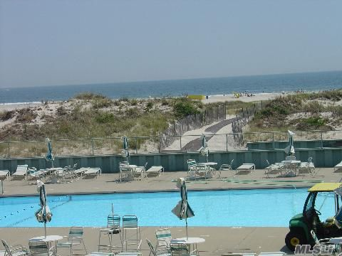 Sale May Be Subject To Term & Conditions Of An Offering Plan.Best Location @ Lido Townhouse!! Direct Oceanfront 2Bdrm,2 Full Bth End Unit.23X8Ft.Terrace W/Spectacular Panaramic Views In Private Gated Condo Community W/ Solar Heated Huge Immaculate Pool.Live In Serenity On The Beach.Owner Very Motivated!!!!!!!!!