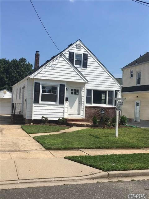 Completely Renovated Home Located North Of Hempstead Turnpike (Garden City Border), All New Roof, Siding, Windows, Central Air, Kitchen, Baths, Crown Molding, Doors, Hardwood Floors, Carpet. To Much To List.. Move Right In.. Diamond!! West Hempstead School District #27.
