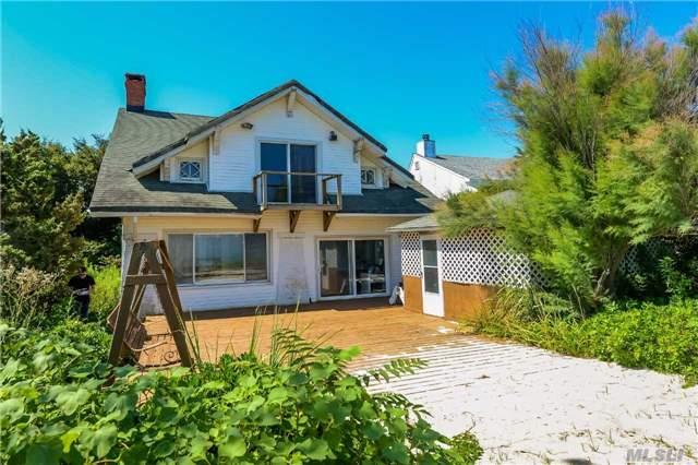 Live The Good Life On The Beach!! Make This Home Your Own. Perfect Location With 50 Feet Of White Sandy Beach Amazing Sunsets! Endless Possibilities!! Do Not Pass This Opportunity By! Taxes Do Not Reflex Discounts And Rebates.