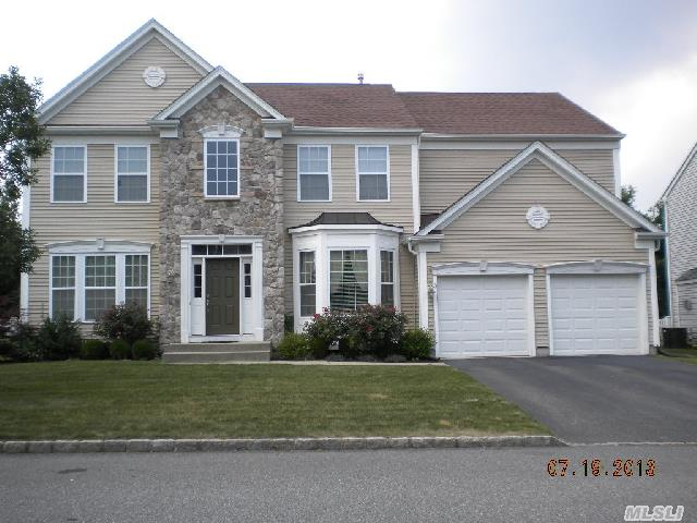 Beautiful Monroe Colonial In Gated ' The Village' Community. Gas Fireplace In Den. High End Hardwood Floors In Lr, Dr, Library And Foyer. Partially Finished Basement W/ Terraced Egress Window. Master Suite W/4 Pc Bath. Short Sale Under Contract - Pending Bank Approval