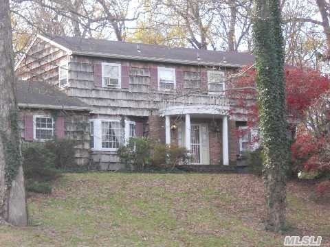 Picturesque Hilltop Setting.Huge Colonial On Beautiful Cul-D-Sac.   Hardwood Floors Throughout. Very Large Rooms, Abundance Of Closets. Great Potential With Level Backyard, 1 Acre Prop. Priced For Offers.Close To Huntington Village & Nyc Train Service. Taxes Being Professionally Grieved,  Newly Finished Basement.