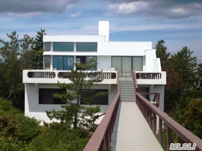 This Prestigious Quogue Oceanfront Home Boasts Spectacular Ocean Views. There Are Additional Waterviews Of The Quogue Canal. The Interior Gallery Style,  With Soaring Ceilings,  Is An Art Lovers Dream. This Pristine Home Features 5 Bedrooms,  6.5 Baths,  And Huge Open Living Spaces. The Coral Floors & Fireplace Are Breathtaking.