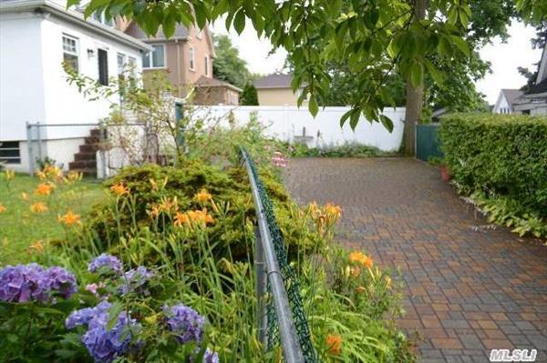 Paved driveway and back yard