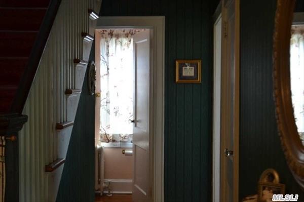 First Floor Hallway into Half Bath