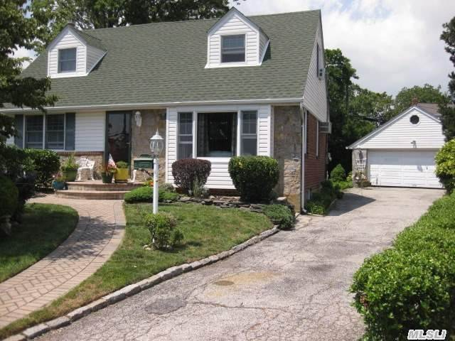 Beautifully Maintained Cape On Quiet Street In Convenient East Meadow Location. Many Recent Interior Upgrades Including Newer Bath And Kitchen With Stainless Steel Appliances. Open Floor Plan That Is Perfect For Ease Of Living And Entertaining. Park Like Yard Setting With Pond,  Patio And 2 Car Garage.