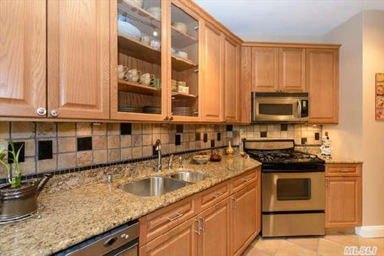Luxurious Gated Community-Country Club Lifestyle! Move Right In To This Gorgeous 3 Bed,  2 Full Bath Condo With Every Amenity! Custom Granite Eik With Ss App And 43' Cabinets. Features Inc. Vaulted Ceil, Wainscoting, Cherry Hw Floors, Cac, Skylilght & Crown Moldings. 24Hr Gated Comm Offers In/Out Pools, Gym, Tennis, Playgound, Restaurant, Conceirge, Valet Pkg, Lake W/Boating, Plgrnd