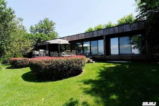 Distinctive Mid-Century Modern Home On The Sound. Iconic Glass And Redwood, Designed For Their Personal Use By Renowned  Architects Abercrombie And Vieyra. Meticulously Restored And Landscaped By Present Owner! Open Plan, 4 Bedrooms, 2 Baths.Steps To Pvt. Beach. Enjoy Panoramic Views Of Li Sound, Along With Nature's Backdrop Of Magnificent Sunsets! New To The Market!