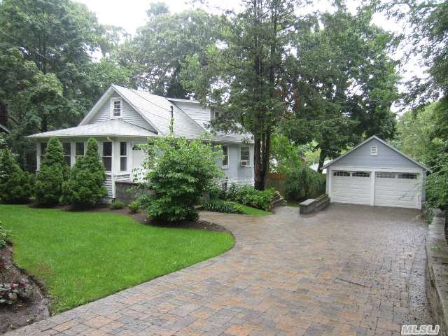Wow! Walk To Li Sound From This Beautiful 3Br,  2 Bth Exp Cape Filled With Charm! Built-In Bookcases,  China Cabinet,  French Doors W/Glass Knobs,  Hw Floors,  Updated Kitchen W/Granite,  Lr W/Brick Fplc,  Replacement Windows,  10 Year Old Roof,  Enclosed Porch,  Full Bsmt,  2 Car Gar,  Nicely Lndscpd W/Beautiful Brick Pavered Double Driveway,  Walkway,  & Patio,  Low Taxes,  Must See!