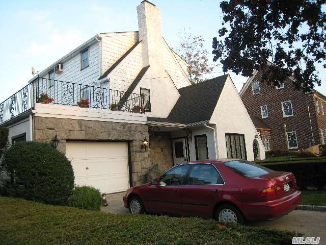 Charming Colonial With Mediterranean Flair. Atrium Entrance,  Rear Of Home Boasts Glass Walls With Stunning Water And Bridge Views. Dead End Private Street. House Can Be Expanded For More Living Space. Great Flow On Main Level For Entertaining.Location!!!Location!!!Location!!!