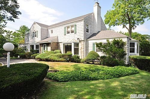 Gracious Living Describes This Center Hall Colonial With Huge Rooms,  Wonderful Flow,  Magnificent Property In The Heart Of Hewlett Harbor. There Are 2 Dens On The First Floor,  One Is A Family Room Perfect For An Entertainment Center,  The 2nd Is A Study With A Fireplace. 2nd Floor Layout Of Master Suite Plus The 4 Additional Bedrooms Is Fantastic