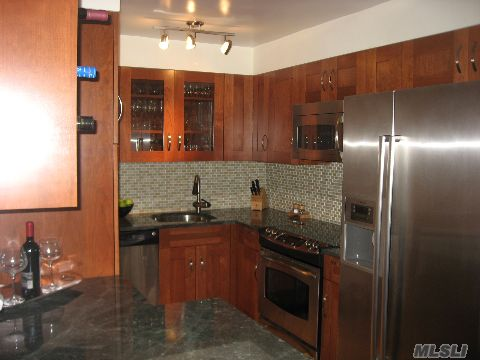 Meticulous 2 Bedroom Unit.  New Kitchen With Stainless Steel Appliances And Granite Countertops.  Great Terrace Views