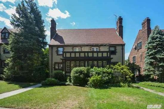 Classic Semi-Detached Tudor In Prime Forest Hills Gardens Location. Light-Filled Sunroom/Entry Foyer,  L/R W/ Architectural Wood-Burning Fireplace,  Large Formal D/R,  Eik With Door To Lush Pvt Backyard,  Large Mbr W/ French Doors To Terrace,  Fin Bsmt Family Rm W/ Great Potential. Lovely Yard/Garden & Det 1Car Garage.