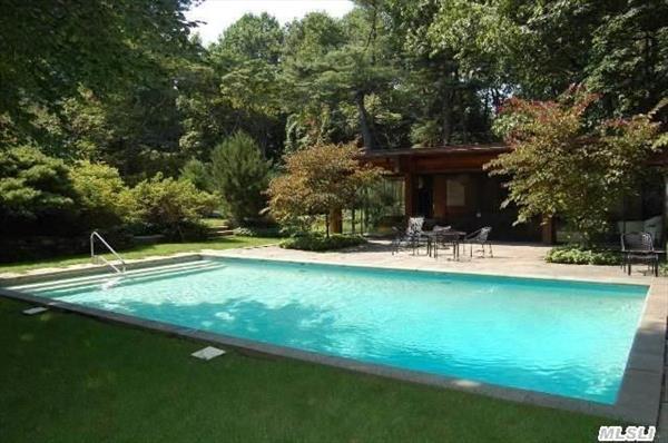 Pool with pool house behind