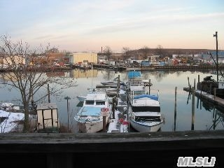 High Visibility Waterfront Bldg. Of Mixed Use. 2-3 Bd Apts 2 Fl; Offices-1st Fl,  New Bulkhead,  New 150' Floating Dock. With Potential Income,  Good Investment.