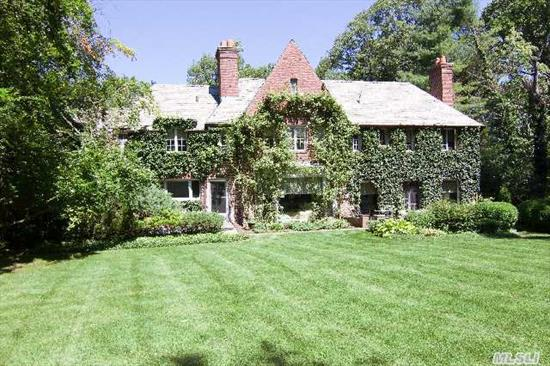 Classic Stately Brick Colonial Situated On 1.14 Plush Park-Like Acreage. Majestic Gardens,  Towering Trees,  Enchanting Vistas From Every Room. Home Boasts 4 Bedrooms,  3.5 Baths,  And 4 Fireplaces. Har-Tru Tennis Court. Exterior Automatic Gas Generator. All Located In Desirable Flower Hill In Manhasset.