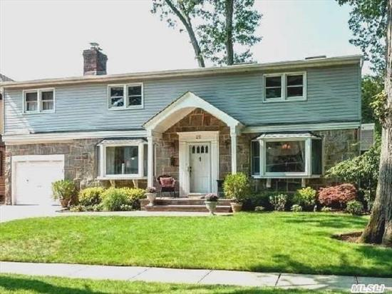 Move Right In To This Magnificent Mid Block Colonial. New Granite Kitchen,  Tremendous Family Room With Hardwood Floors And Stone Fireplace. Formal Lr W/F.P,  Formal Dr,  Both W/Hardwood Flooring. Full Finished Basement,  Stone Patio And Decking. Truly A Turn Key Beauty,  Wont Last.