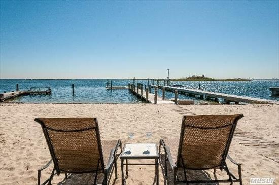 Amazing Bayfront Beauty Completely Renovated Inside And Out With State Of The Art Kitchen, Quartz Countertops, Ss Appliances, Mosaic Backsplash, Porcelain Floors W/Radiant Heat,  Led Lighting, Cultured Stone Fpl, New Roof, Siding,  Walls Of Windows To Capture The Beauty Of The Bay.Vacation In Your Own Backyard On Your Own Sandy Beach. Views Of Jones Beach Come See....