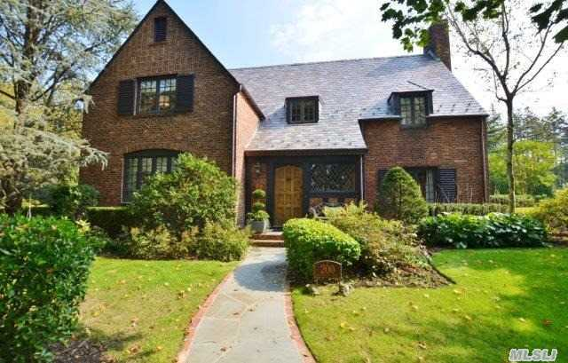 Spectacular English Tudor In Munsey Park With Extra Buildable Lot.  Unique Architectural Details. Completely Renovated 2010.  Large Eik/Marble Counter Tops/Sub-Zero Appliances.Mud Closet,  Music Rm,  Fin.Basement/Playrm/Fpl. Master Suite/Fpl/Fbth/Audio System.  New Slate Roof,  New Generator,  New Bluestone Patio,  All New Closets,  Alarm System,  Intercom,  Surround Stereo System