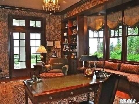 Finely Detailed Library With Custom Cherry Millwork And French Doors To Terrace