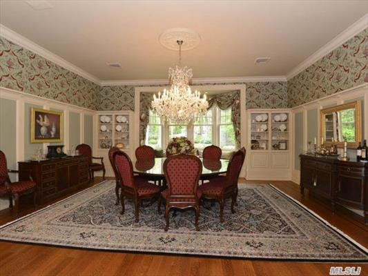 Formal Dining Room With Built-Ins And Window Seat