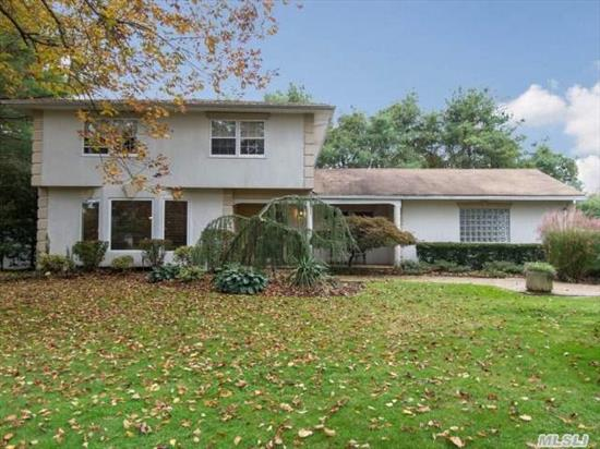 Great Colonial With Open Floor Plan!  Great For Entertaining!  The Street You've All Been Waiting For!  4 Bedrooms Up,  1 On Main Floor.  Syosset Schools.