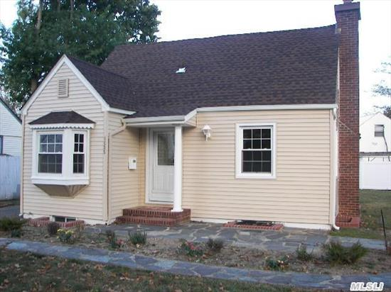 Completely Renovated Cape,  With New Roof, Alumn Siding. Ready For New Homeowners,  4 Bedrooms,  New Bath,  Eik,  Stainless Steele Appl. Fire Place,  Porch,  Att Garage, Full Basement/Bar,  Half Bath,  Entertainment Area,  Gas Heat Near School And Shopping!!!