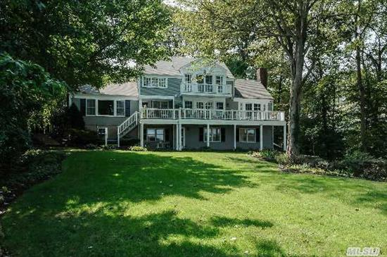 Breathtaking Views Of Lloyd Harbor From Every Room. Beautiful Williamsburg Colonial Set On Over 2 Acres With Stunning Perennial Gardens And Well Manicured Landscape Located On Quiet Cul De Sac. Har Tru Tennis Court, Private Beach And Mooring.