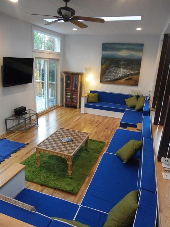 Modern home in quiet location in Ocean Bay Park, close to the ocean and the Seaview border.  Featuring fabulous soaring ceilings, this home feels spacious, light, and airy.  Massive windows in every room.  Open floor plan with sunken living room.  4 bedrooms, 2 full baths.  Brand new kitchen! All new furnishings!  Central air conditioning and heat. <br>