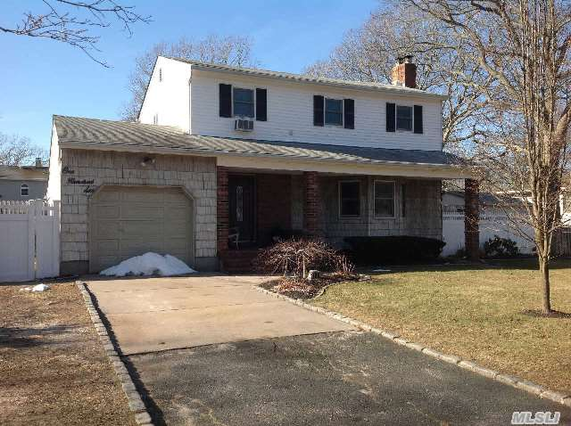 Manor Park Offers This 4 Bedrm, 2 Bath Colonial With 3/4 Fin Basmt In South Manor School District.New Kit W/Ss Appl And Quartz Countertops & Ceramic Tiled Flrs. Liv Rm W/Wood Burning Stove & Beautiful Hardwd Flrs,  Dine Rm, Newer Bathrms, Sunrm, Basemt Has A Bar For Entertaing, New Laundry Rm, Utility Rm, Pvc Fence, Property Is Fully Fenced, 200 Amp Elec, Newer Windows, *Txs$8, 173