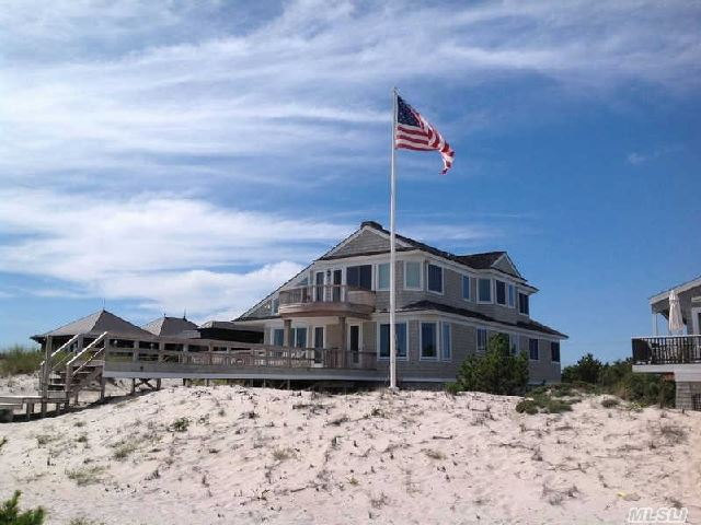 Prime Location Between The Bridges. Spectacular Ocean Views With Two Decks On 75 Feet Of Ocean Frontage. Home Is Approx. 3800 Sq. Ft,  Jetty Protected And Sustained No Damage During Sandy. Please See Attached Floorplan,  Video And Survey.