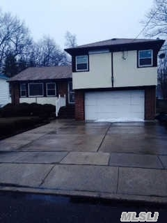 This Split Boasts 3Brs,  2Fbths,  Attached 2 Car Garage And Full Basement! Great Location! House Needs Some Tlc!