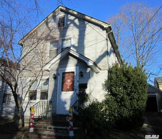Charming Village Colonial With Detached Garage.  Close Proximity To Town And Train.   Great Investment Opportunity.  House Being Sold As Is.