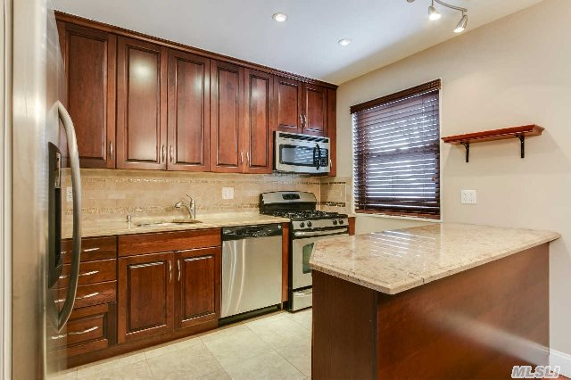 Beautiful 2 Bedroom Co-Op,  Hardwood Floors Throughout Also Features A New Stainless Steel Kitchen With Granite Counters,  New Bathroom And Two Bedrooms With The Master Bedroom Having Custom Built His And Her Closets. Co-Op Is Near Transportation.